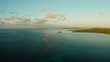 Coast of Siargao Island covered with forest during sunrise, aerial view. Summer and travel vacation concept. Siargao,Philippines.