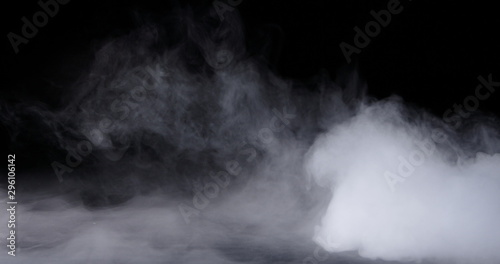Fototapeta Realistic dry ice smoke clouds fog overlay perfect for compositing into your shots. Simply drop it in and change its blending mode to screen or add. obraz