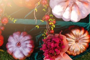 Obraz na płótnie Canvas Halloween decor in a garden, autumn decor with red pumpkins