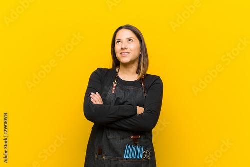 Fotografie, Obraz  hairdresser woman feeling happy, proud and hopeful, wondering or thinking, looki