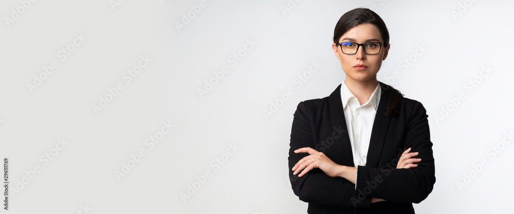 Fototapety, obrazy: Serious Business Lady Looking At Camera Standing In Studio, Panorama