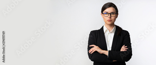 Vászonkép  Serious Business Lady Looking At Camera Standing In Studio, Panorama