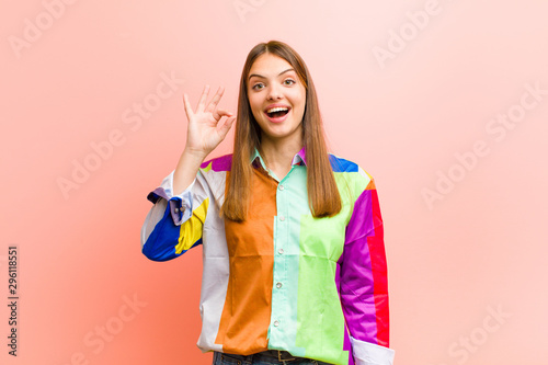 Fotografie, Obraz  young pretty woman feeling successful and satisfied, smiling with mouth wide ope