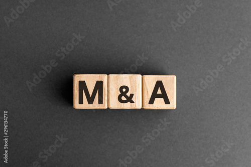 M&A - acronym from wooden blocks with letters, mergers and acquisitions M&A conc Wallpaper Mural