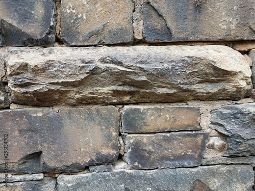 grey rectangular stone or rock and cement wall