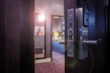 Parted Front Door Of A Hotel Room