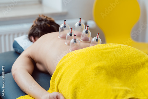 Stampa su Tela  Session in the physical therapy with cupping