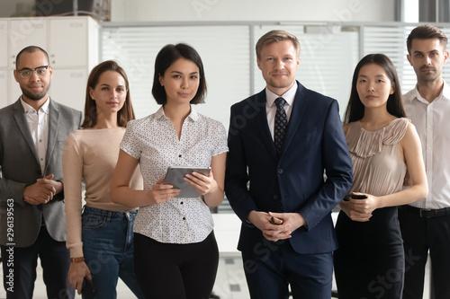 Obraz Portrait of successful diverse employees team standing in office - fototapety do salonu