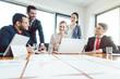 Leinwandbild Motiv Team of office workers discussing business development