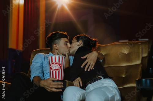 Romantic loving couple at the cinema, Portrait of young couple kissing and enjoying the movie during a date at the cinema theater Fototapeta