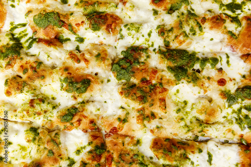 Papiers peints Affiche vintage Appetizing focaccia with pesto. Traditional italian food. Close-up. Background. Space for text.