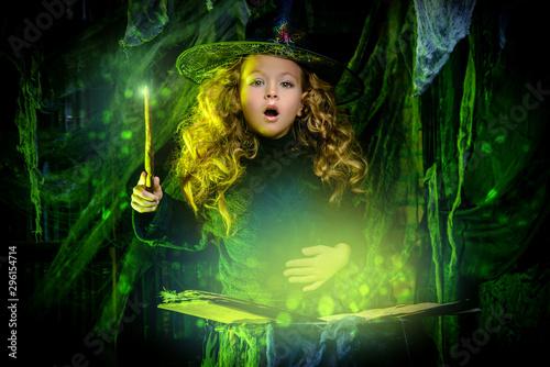 little witch casts a spell Fototapeta
