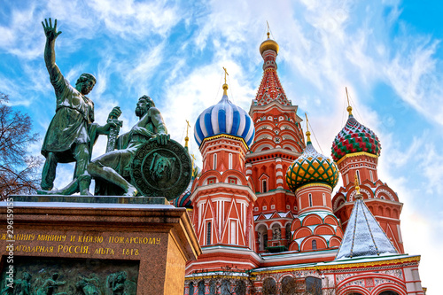 Poster Con. Antique Saint Basil's Cathedral and monument to Minin and Pozharsky on Red Square in winter in Moscow, Russia