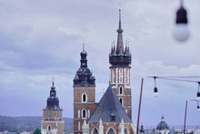 Roofs Of Houses And A Church A...