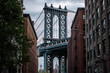 View of one of the towers of the Manhattan Bridge from the streets of the DUMBO district, Brooklyn, NYC