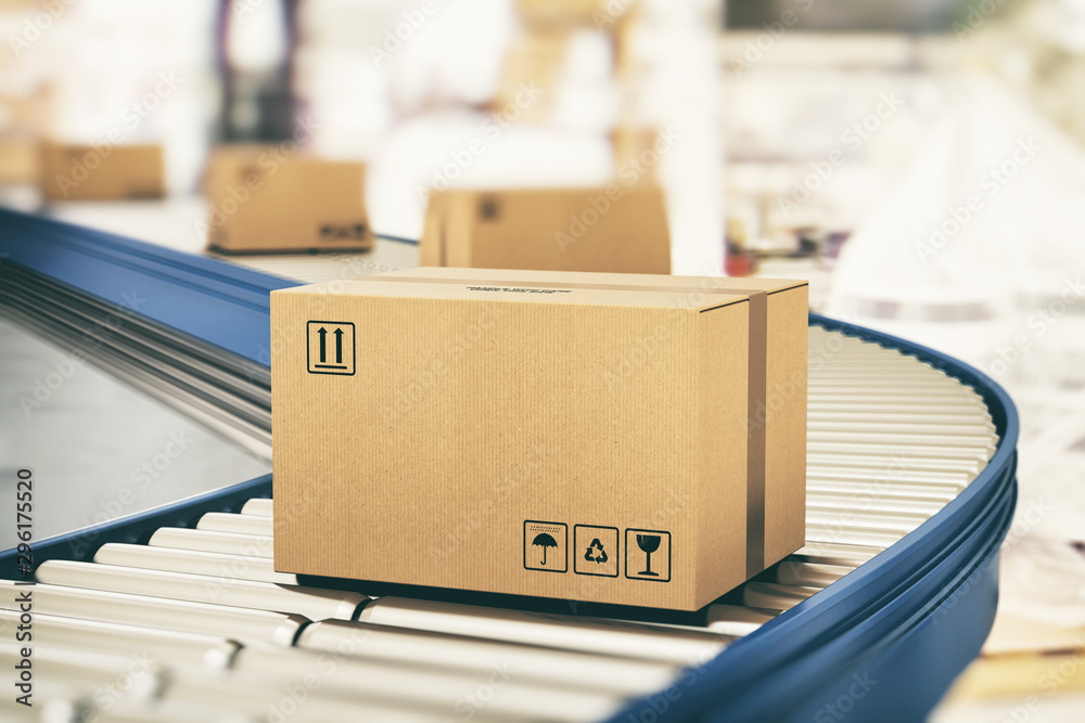 Fototapety, obrazy: Cardboard boxes on conveyor rollers ready to be shipped by courier for distribution