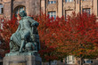 Leinwanddruck Bild - Statue of great scientist Otto Guericke in Magdeburg in red and golden Autumn colors, Germany