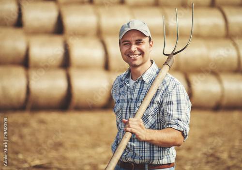 Fotografia, Obraz Farmer holding a pitchfork