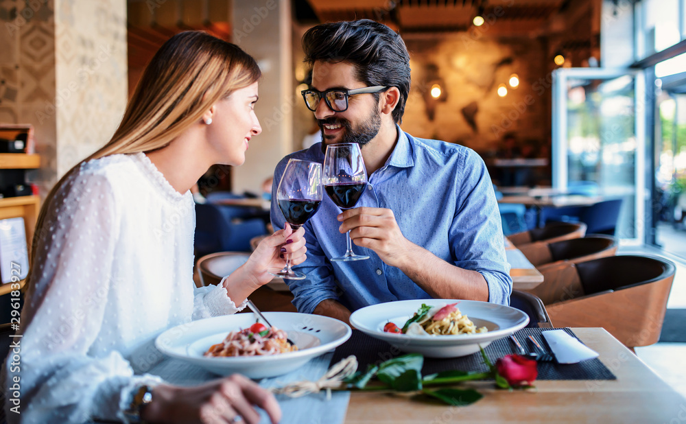 Fototapety, obrazy: Paste and red wine. Young couple enjoying lunch in the restaurant. Lifestyle, love, relationships, food concept