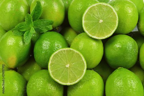 Many fresh limes on white background.