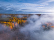 canvas print picture - Aerial view of Dreamy foggy autumn landscape