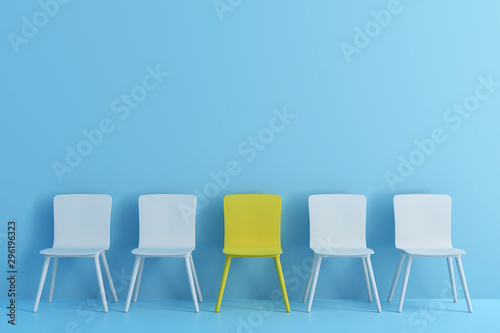 outstanding yellow chair among light blue chair Wallpaper Mural