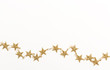 Gold star string on a white background