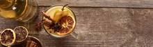 Top View Of Warm Pear Mulled Wine With Spices And Dried Citrus On Wooden Rustic Table, Panoramic Shot