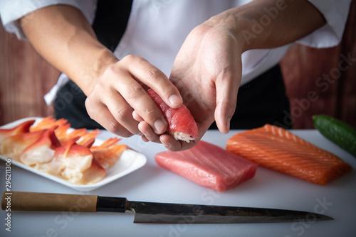japanese sushi chef making nigiri sushi Wallpaper Mural