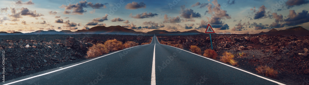 Fototapety, obrazy: Image related to unexplored road journeys and adventures.Road through the scenic landscape to the destination in Lanzarote natural park