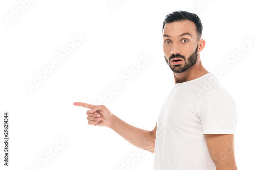 Valokuva  surprised man pointing with finger and looking at camera isolated on white
