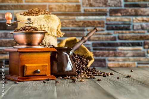 still life with coffee beans and old coffee mill on the wooden background,coffee Tableau sur Toile