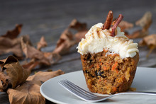Carrot Cake Cupcake With Cream Cheese Icing With An Autumn Background
