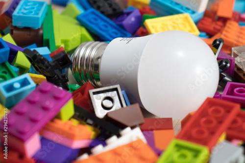 Obraz Light bulb in the middle of colorful toy bricks - fototapety do salonu