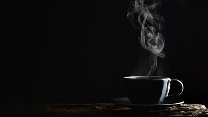 hot coffee, tea or chocolate in black cup on wooden plank