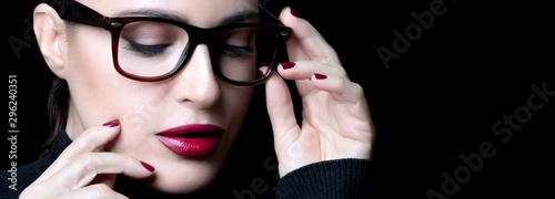 Beautiful young woman wearing glasses Wallpaper Mural