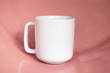 Plain blank white 11oz cup in front of a pink shiny surface - simple digital mug mock up