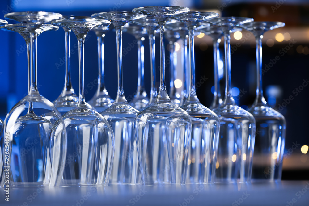 Fototapeta Empty clean glasses on counter in bar