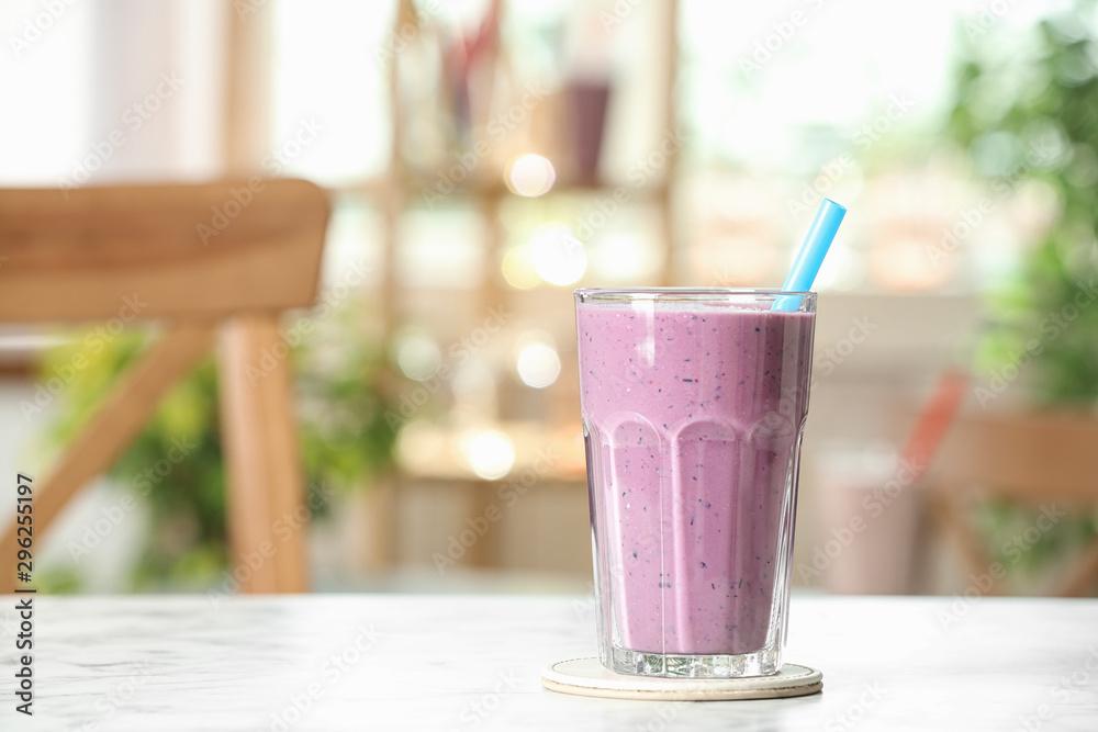 Fototapeta Tasty milk shake on white marble table indoors. Space for text