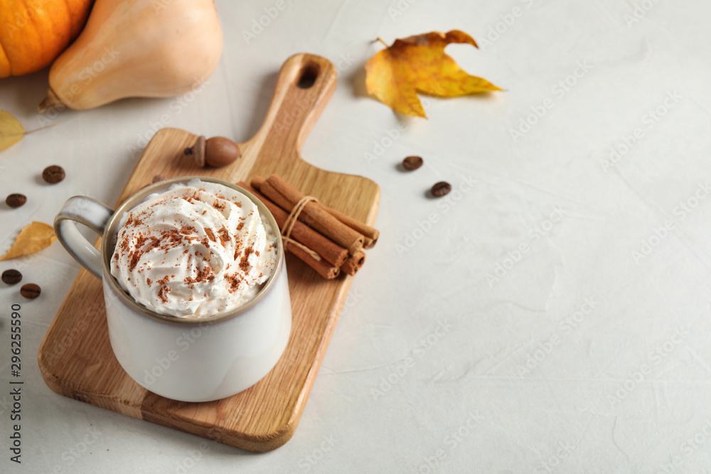 Fototapeta Cup with tasty pumpkin spice latte on light table, space for text