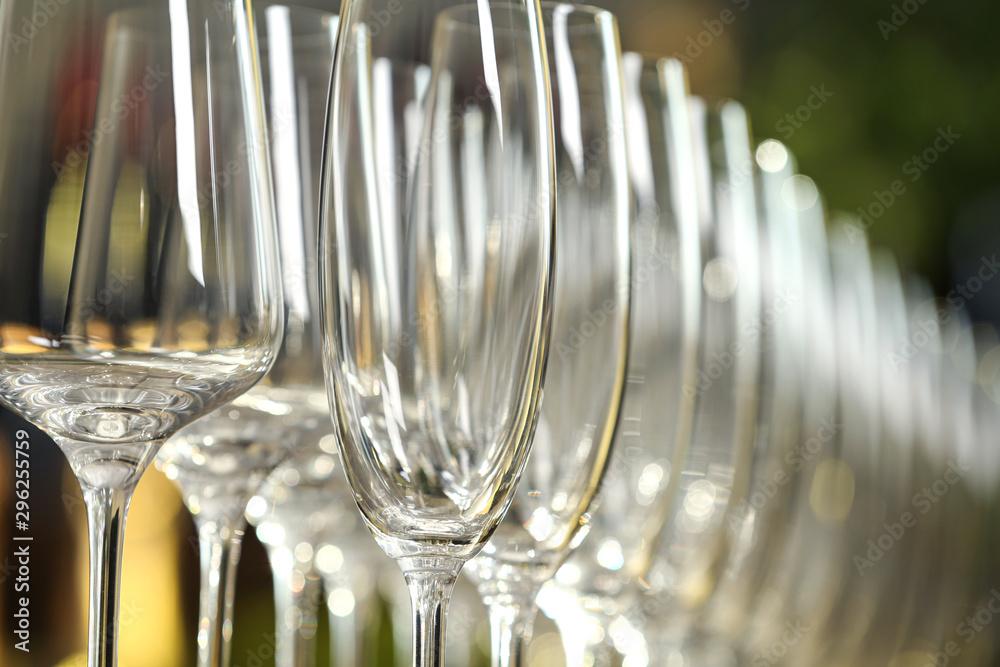 Fototapeta Set of empty glasses on blurred background, closeup