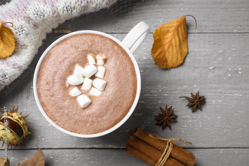 Fototapeta Flat lay composition with cup of hot drink on grey wooden table. Cozy autumn atmosphere