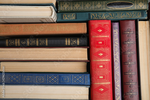 Stampa su Tela Stack of hardcover books as background, top view