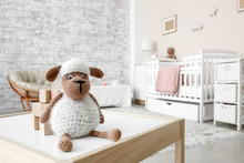 Wooden Cubes With Toy Sheep On Table In Children's Room