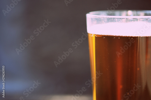 Foto auf Leinwand Alkohol Glass with a light beer closeup in retro style