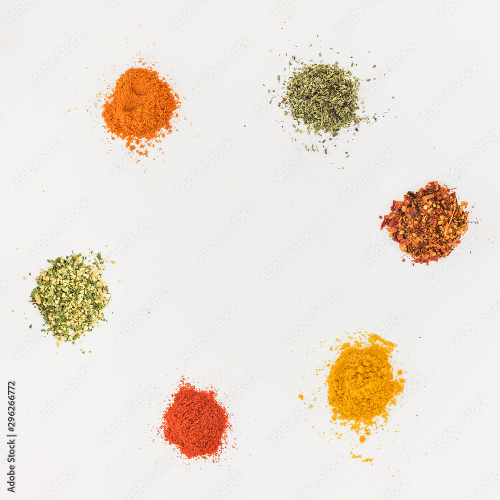 Fototapety, obrazy: Various flavourings on white table