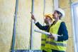 Leinwandbild Motiv Construction manager and architect checking the insulation works
