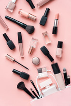 Decorative Cosmetic Makeup Women Products Accessory Pouring From Shopping Bag On Pink Flat Lay Background, Beauty Products Cheap Discount Retail Offer Online Purchase, Top View Above Vertical Photo