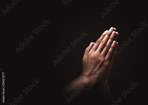 Praying hands with faith in religion and belief in God on dark background Tapéta, Fotótapéta
