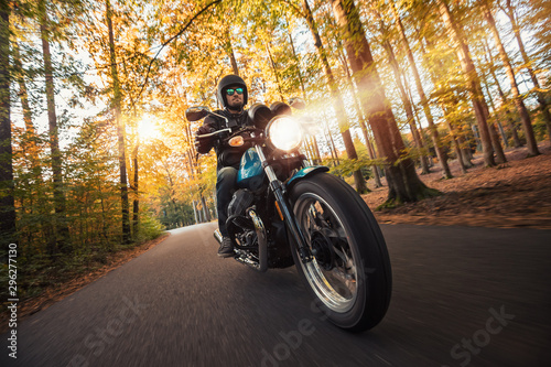 Motorcycle driver riding in foreste landscape Canvas